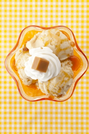 Top view image of cheese ice cream on a yellow striped background photo
