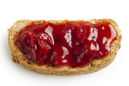 smeared: Close-up image of wheat toast and strawberry jam on white Stock Photo