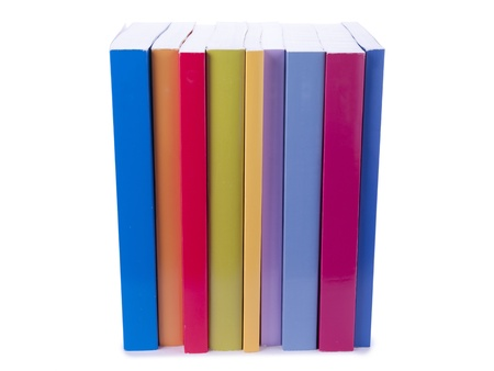 educational tools: Close-up image of a stack of colorful books on a white surface