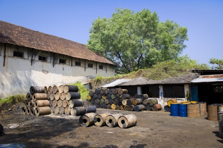 Empty oil drums sitting in a courtyard in Kochi, India. Stock Photo