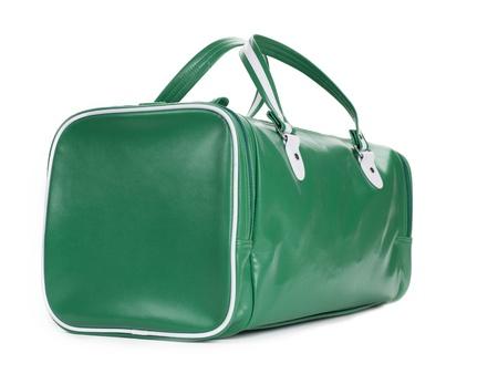 duffel: A green duffel bag shot on an angle on white