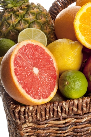 Close-up cropped view of slices of fruits in a wicker basket. Stock Photo - 17487904