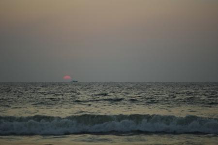 The sun on the horizon on Pollethai Beach, India.