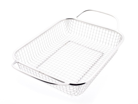 grate: Empty Metal Serving Basket sitting on an angle on white background. Stock Photo