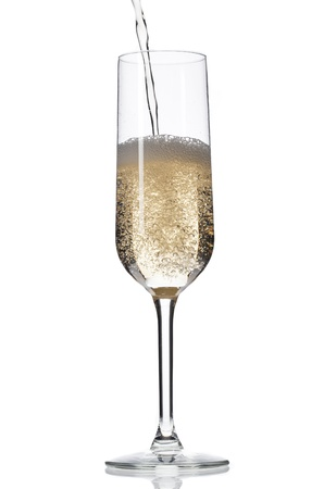 Close-up image of champagne being poured in champagne flute over white background. Stock Photo - 17496710