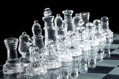 ch: Close-up shot of chess pieces reflecting on chess board over dark background Stock Photo