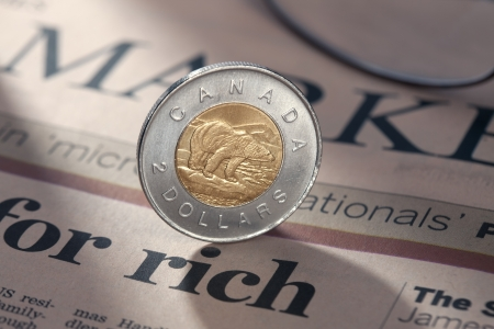 Detailed shot of a coin with a newspaper. Stock Photo - 17494421