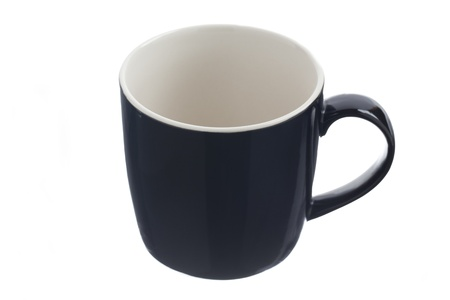 displayed: Close-up of a empty coffee mug displayed on white.