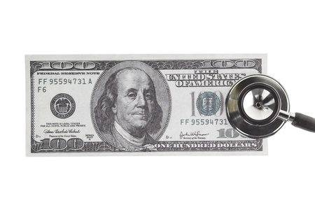 doctor money: Close-up of a hundred dollar bill with a stethoscope  displayed on white.