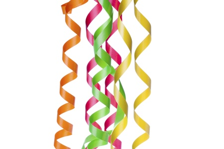 detailed image: Detailed image of multi colored streamers against plain white background. Stock Photo
