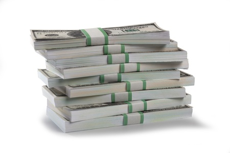 earn money: Detailed shot of stacks of US dollars bundle on white background.