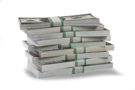 earn money: Detailed shot of stacks of US dollars bundle on white background.