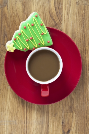 Coffee with Christmas decoration in the top of a brown table photo