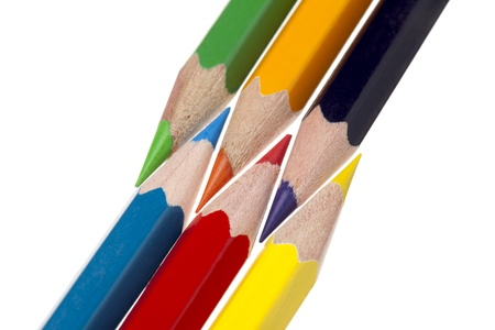 Close-up shot of color pencils isolated on white background photo
