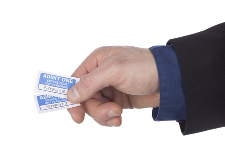 Cropped close-up image of a businessman holding tickets against white background, Model: Winter Bourne Stock Photo - 17496314