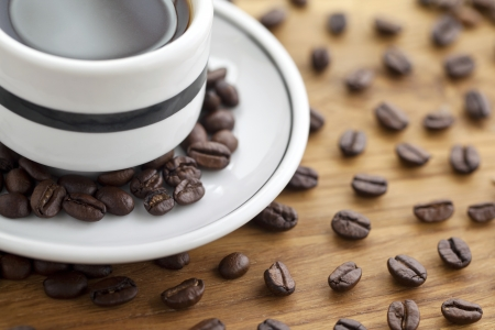 decora: Close-up shot of coffee drink with beans on table surface
