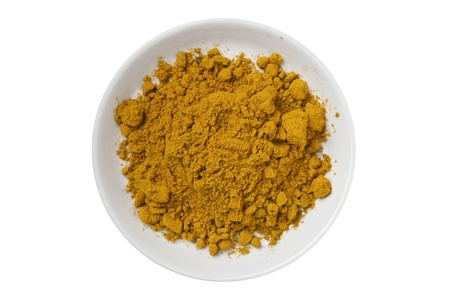 Curry powder on a white bowl photo