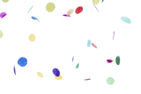 Detailed image of decorative colorful confetti falling against plain white background. Stock Photo - 17494025