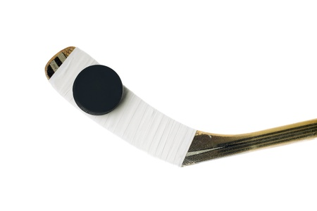 hockey stick: Hockey stick and hockey puck in a vertical image