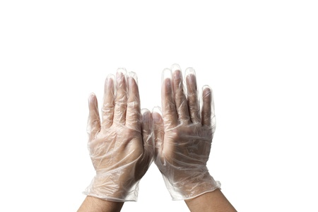 protective: Close-up image of human hands with transparent surgical gloves.