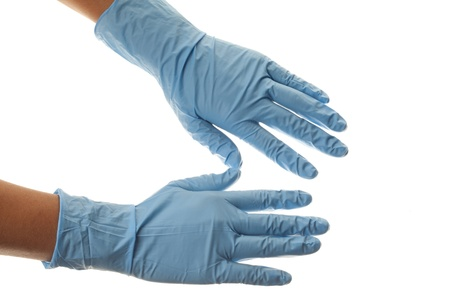 protective: Close-up image of a human hand wearing blue surgical gloves.