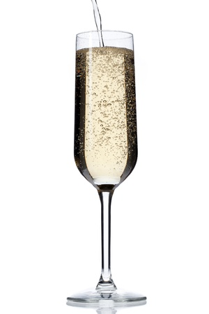 Close-up shot of alcoholic drink falling in champagne flute against white background. Stock Photo - 17496711