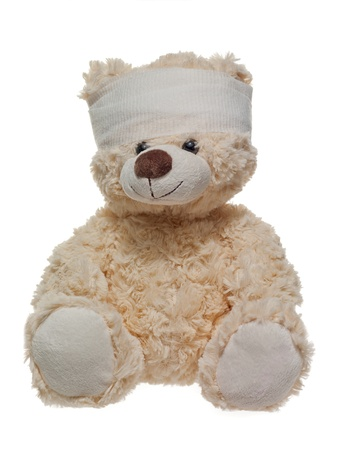 Little teddy bear wrapped with gauze on his head. Stock Photo