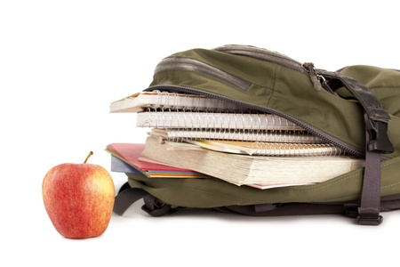 Close up image of school bag with apple against white background photo