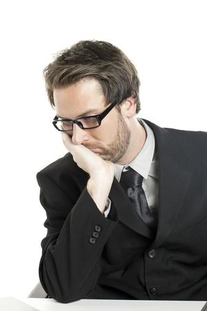 hesitating: Portrait of thinking businessman against white background Stock Photo