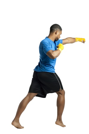 aieron: Rear view shot of punching male boxer over a white background