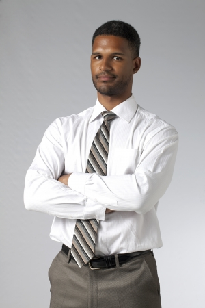 aieron: Businessman with crossed arm looking at the camera