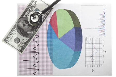 Image of stethoscope with stock chart and dollar against white background photo