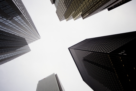 property development: Low angle shot of tall commercial buildings against sky.