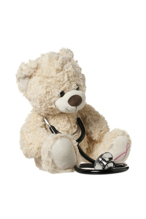 Teddy bear with a stethoscope displayed on white background. Stock Photo