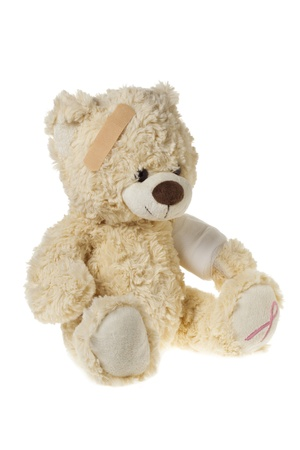 elbow band: Teddy bear with bandages and aids symbol displayed on white background.
