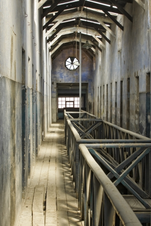 jailhouse: View of a old peeled wall and wooden walkway of Argentina jailhouse. Stock Photo