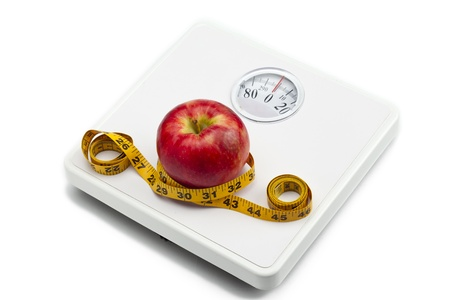 bathroom scale: Image of weight scale, red apple and measuring tape isolated on white background