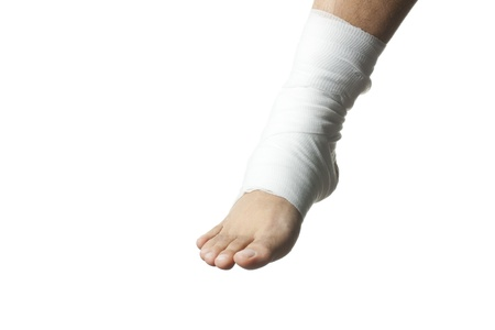 Close-up image of white medicine bandage wrapped on ankle. photo
