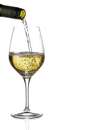 Close-up shot of white wine being poured in glass photo