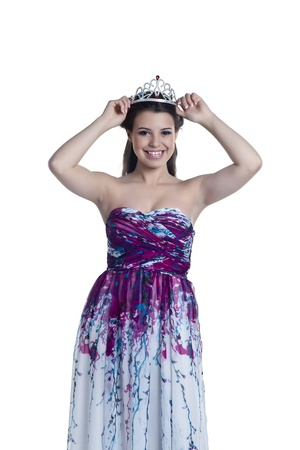 prom queen: Close-up image of cheerful prom queen isolated on a white surface