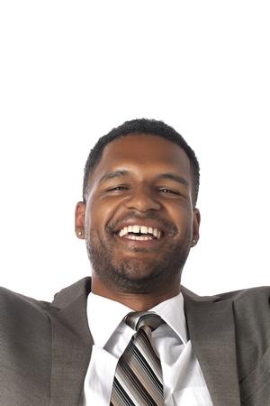 aieron: Close-up immagine di uomo d'affari felice isolato su una superficie bianca