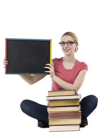 educational tools: Close-up image a happy student holding black empty board sitting on a white surface