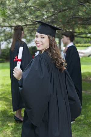 Close up image of a lady smiling on her graduation day photo