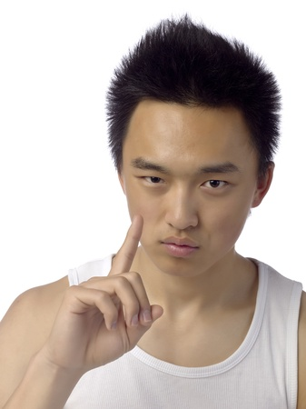 Close-up image of a young man with his hand pointing up over the white background Stock Photo - 17517036