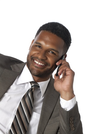 aieron: Smiling black American businessman with his cell phone