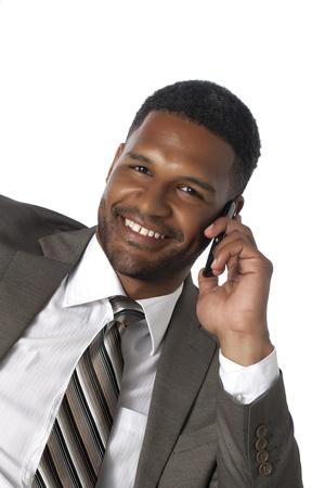 aieron: Sorridente nero uomo d'affari americano con il suo cellulare