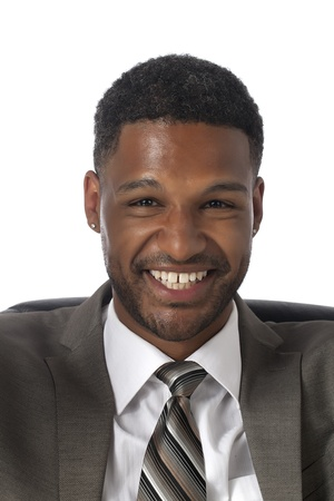 aieron: Close-up image of an African-American businessman in business suit smiling over the white background Stock Photo