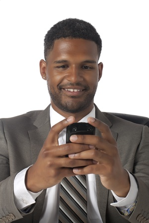 Close-up image of an African-American businessman in a formal suit texting isolated on a white surface photo