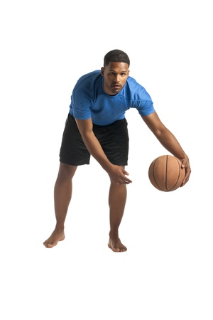 aieron: Portrait of African-American man dribbling the ball over the white surface