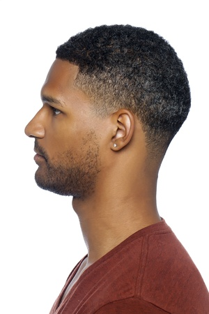 aieron: Side view shot of an African-american man over a white background